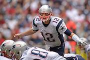 Dec 1, 2013; Houston, TX, USA; New England Patriots quarterback Tom Brady (12) yells against the Houston Texans during the second half at Reliant Stadium. The Patriots won 34-31. Mandatory Credit: Thomas Campbell-USA TODAY Sports