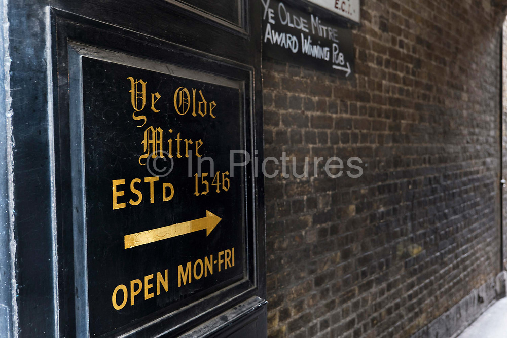 A direction sign to Ye Olde Mitre Tavern on the 4th October 2019 in London in the United Kingdom. Ye Olde Mitre Tavern is a traditional 1547 real ale pub in central London.