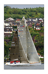 Yachting- The first days racing  of the Bell Lawrie Scottish series 2003 at Gourock.  The wet start looks set to last for the overnight race to Tarbert...Keith Miller's new Swan 45 ' Crackerjack' overshadows Dave Ovington's Mumm 30 GBR1305R Ovington Boats Like. Class One...Pics Marc Turner / PFM