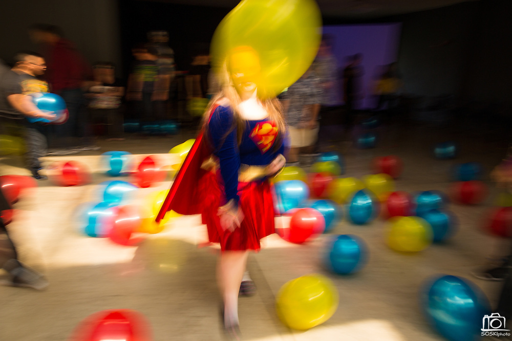 Madison Holmes, 17, dances in her Superman costume during the Super Hero Dance at Milpitas High School in Milpitas, California, on April 18, 2014. (Stan Olszewski/SOSKIphoto)