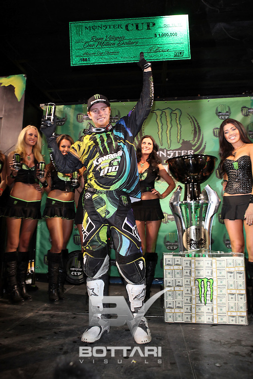 LAS VEGAS, NV - OCTOBER 15:  Ryan Villopoto, rider of the #2 Monster Energy Kawasaki 450, celebrates the win of the inaugural Monster Energy Cup by holding up his check for $1 Million on October 15, 2011 in Las Vegas, Nevada.  (Photo by Jeff Bottari/Getty Images)
