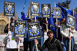 © Licensed to London News Pictures. 01/04/2019. LONDON, UK. Satirical placards, depicting key UK Brexit-related personalities, held by Pro-Remain supporters protest outside the Houses of Parliament as MPs debate eight motions related to Brexit with voting to begin later this evening.  Photo credit: Stephen Chung/LNP