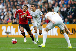 Memphis Depay of Manchester United is challenged by Jack Cork of Swansea City - Mandatory byline: Rogan Thomson/JMP - 07966 386802 - 30/08/2015 - FOOTBALL - Liberty Stadium - Swansea, Wales - Swansea City v Manchester United - Barclays Premier League.