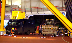 """An armoured van being loaded by police, after a foiled raid on a diamond display in The Millennium Dome at Greenwich.  Six people were arrested, including four in the Money zone vault, and two by the River Thames, where the robbers had a powerboat waiting to escape from the scene.   *... The raiders used a bulldozer to break into the Dome, and had it been successful, it would have been the world's largest ever robbery.    * 08/11/2001: Police foiled the """"robbery"""" of the jewels when they caught raiders red handed as they smashed their way in using a mechanical digger, an Old Bailey court heard, at the opening of the trial of six men accused of plotting to rob the De Beers Millennium Diamond Exhibition with others unknown."""