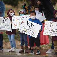 Rehoboth Christian School Pre-K students hold signs they designed as they wait for the Rehoboth Lynx championship parade to drive down Rehoboth Drive Friday morning in Rehoboth.