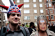 The Republican campain calling for the abolition of the Royal family held their own street party in Red Lion Square in Holborn, London. A couple with republican hat and mask saying Best before Circa 1700