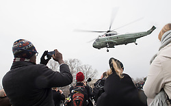 People watch as former President Barack Obama departs the inauguration via a helicopter, on Capitol Hill in Washington, D.C. on January 20, 2017. President-Elect Donald Trump was sworn-in as the 45th President. Photo by Kevin Dietsch/UPI