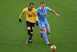 27 November 2016 - Premier League - Watford v Stoke City - Roberto Pereyra of Watford in action with Charlie Adam of Stoke City - Photo: Marc Atkins / Offside.
