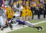 MANHATTAN, KS - NOVEMBER 14:  Wide receiver Danario Alexander #81 of the Missouri Tigers leaps over defensive back Darious Thomas #15 of the Kansas State Wildcats along the sidelines in the first quarter on November 14, 2009 at Bill Snyder Family Stadium in Manhattan, Kansas.  (Photo by Peter G. Aiken/Getty Images)