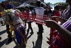 © Licensed to London News Pictures. 24/01/2016 Ipoh, Malaysia. A devotee with metals hooks pieced on his back arrives at Kallumalai Murugan Temple in Ipoh, Malaysia, during the Thaipusam Festival, Sunday, Jan. 24, 2016. Photo credit : Sang Tan/LNP