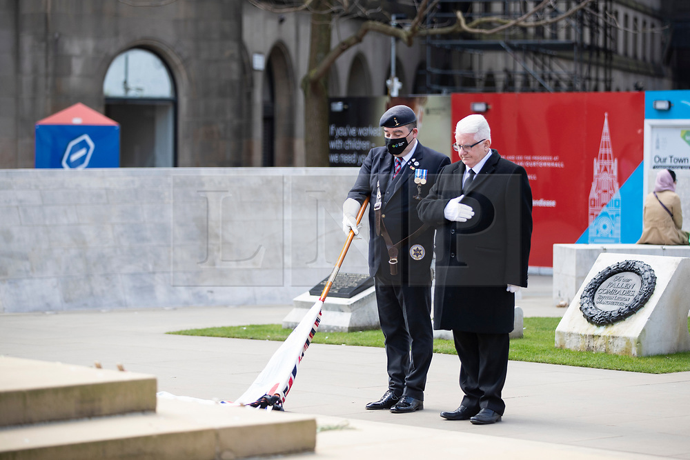 © Licensed to London News Pictures. 17/04/2021. Manchester, UK. [L-R]  Daniel Millan representing the Royal Signals Association and the Association of ex-Jewish servicemen and women and Patrick Boyce-Thomson, representing the Caledonian 204 Manchester, stand alone at Manchester Cenotaph for silence in memory of HRH Duke of Edinburgh, Prince Philip at 3am. Photo credit: Kerry Elsworth/LNP