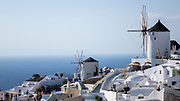 Beautiful Morning view in Oia, Santorini, Greece. White village with windmills, blue sky and Aegean sea