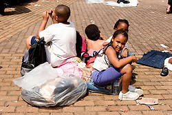 31st August, 2005. New Orleans Louisiana. <br /> Hurricane Katrina.  'Hell on earth.' The Superdome in New Orleans, Louisiana where over 20,000 refugees from hurricane Katrina are crammed into hellish conditions. Children sit guarding the only possessions they have left in the world.<br /> Photo Credit: Charlie Varley/varleypix.com