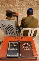 JERUSALEM, ISRAEL - MAY-09-2004 - The faithful pray at the Western Wall in the Jerusalem's Old City. (PHOTO © JOCK FISTICK)