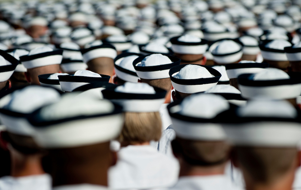 """New midshipmen shortly before taking the Midshipman Oath of Office. Approximately 1,230 young men and women arrived at the U.S. Naval Academy's Alumni Hall, Thursday, July 1, for Induction Day to begin their new lives as """"plebes"""" or midshipmen fourth class (freshmen). """"I-Day"""" culminates when the members of the Class of 2014 take the oath of office at a ceremony at 6 p.m. in Tecumseh Court, the historic courtyard of the Bancroft Hall dormitory. Over 17,400 young men and women applied to be members of the Naval Academy Class of 2014 - a record for USNA."""