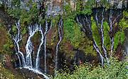 Lake Chuzenji drains via side falls at Kegon Waterfall, Nikko National Park, Tochigi Prefecture, Japan. Kegon Waterfall (Kegon no taki, 97 metres or 318 ft) is the thundering outlet of Lake Chuzenji. Paying for the 100 meter deep elevator gives more impressive views than the free viewing above. Kegon Waterfall  is a short walk from Chuzenjiko Onsen bus terminal.