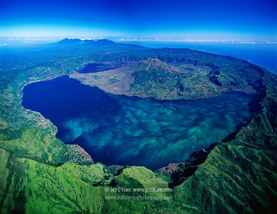 Lake Batur & Mount Batur seen from Mount Abang, Bali, Indonesia.