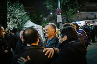 POMIGLIANO D'ARCO, ITALY - 6 MARCH 2018: Antonio Di Maio (center), father of the Five Star Movement leader Luigi Di Maio,  chats with friends and fellow citizens after the celebration for his son Luigi who returned to his his hometown to celebrate the movement's victory in the 2018 Italian General Elections, in Pomigliano D'Arco, Italy, on March 6th 2018.<br /> <br /> The Five-Star Movement, became the first party in Italy, with 33 percent of the vote.