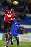 Dominic Iorfa of Ipswich Town (l) jumps for a header over Junior Hoilett of Cardiff City. EFL Skybet championship match, Cardiff city v Ipswich Town at the Cardiff city stadium in Cardiff, South Wales on Tuesday 31st October 2017.<br /> pic by Andrew Orchard, Andrew Orchard sports photography.