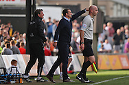 Newport manager Justin Edinburgh (centre) points the way. Skybet football league two match, Newport county v Northampton Town at Rodney Parade in Newport, South Wales on Saturday13th Sept 2014<br /> pic by Mark Hawkins, Andrew Orchard sports photography.