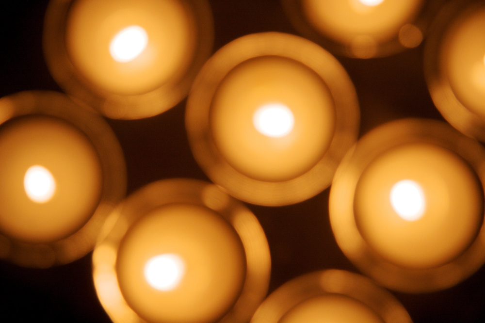 Eight candles, soft focus, overhead.