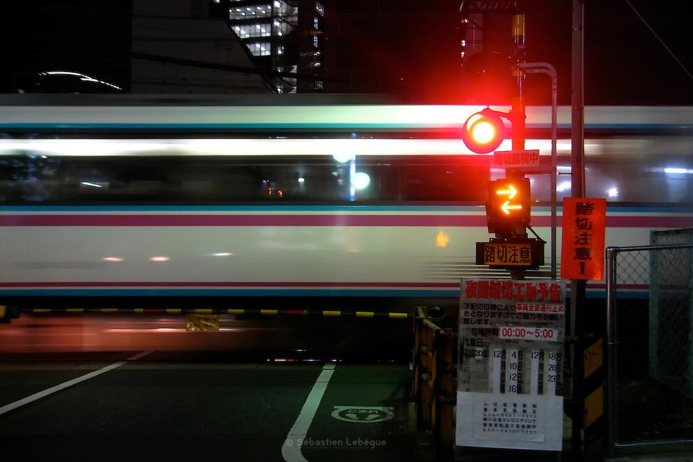 TOKYO, JAPAN, 26 NOVEMBER - Waiting at a rail cross - November 2008