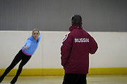 Moscow, Russia, 24/02/2004..AZLK Moskvich chief coach Viktor Kudriatsev training skaters on the club's main ice rink.  Kudriatsev coaching Julia Soldatova, the subject of a dispute between Russia and Belarus, both of whom want her to skate for them...