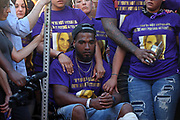 Marcus Martin becomes emotional sitting in his wheelchair during a large vigil for Heather Heyer Sunday night at 4th Street SE and Water Street in Charlottesville, Va. Martin, pictured on the cover of the Daily Progress Sunday, broke his leg when he was thrown into the air by a car that intentionally ran through a crowd of counter protestors after the Unite The Right rally. Heyer was killed and 19 others injured. Photo/Andrew Shurtleff/The Daily Progress