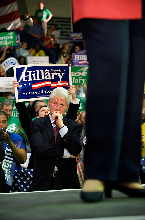 Bill Clinton reacts to Hillary Clinton's speech at a primary election eve at the University of Pennsylvania's Palestra stadium.