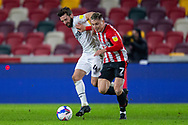 Derby County defender Graeme Shinnie (4) struggles to contain Brentford forward Sergi Canós (7) during the EFL Sky Bet Championship match between Brentford and Derby County at Brentford Community Stadium, Brentford, England on 9 December 2020.