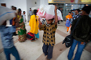Alamin Hasan carries a bag at the Kamalapur Railway Station in Dhaka, Bangladesh, where he works as a porter.  (Alamin Hasan is featured in the book What I Eat: Around the World in 80 Diets.) MODEL RELEASED..