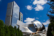 Chicago, Illinois, The Jay Pritzker pavilion at Millennium Park with highrise buildings in the background