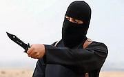 November 13, 2015 - FILE PHOTO -<br /> <br /> 'Jihadi John' Allegedly Killed by US Drone Strike<br /> <br />  A video screen grab showing ISIS executioner Mohammed Emwazi, aka ''Jihadi John.'' The US has claimed he has been killed by a drone stroke in Northern Syria.  ©Exclusivepix Media