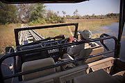 A guide drives along a wooden bridge constructed by Abu Camp to move around the Okavango Delta, Botswana