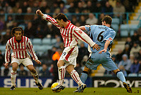 Photo. Glyn Thomas. 22/02/2005.<br /> Coventry City v Stoke City. Coca Cola Championship.<br /> Stoke's Chris Greenacre (L) shields the ball from Coventry's Stephen Hughes.