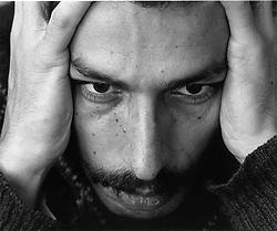Man looking depressed holding head in hands,