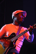 """DURBAN - FILE PIC - 10 April 2006 - Julio """"Gugs"""" Sigauque, accoustic guitarist of the popular South African band FreshlyGround seen here performing as a support act to Robbie Williams..Picture: Giordano Stolley"""