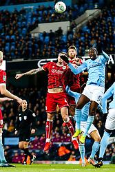 Aden Flint and Nathan Baker of Bristol City are challenged by Yaya Toure of Manchester City - Rogan/JMP - 09/01/2018 - Etihad Stadium - Manchester, England - Manchester City v Bristol City - Carabao Cup Semi Final First Leg.