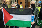 Activists from Palestine Action hold a Palestinian flag at a protest outside the UK headquarters of Elbit Systems, an Israel-based company developing technologies used for military applications including drones, precision guidance, surveillance and intruder-detection systems, on 11th May 2021 in London, United Kingdom. The activists were protesting against the companys presence in the UK and in solidarity with the Palestinian people at a time of a significant rise in tension in Israel and the Occupied Territories following attempts at forced evictions of Palestinian families in the Sheikh Jarrah neighbourhood of East Jerusalem, the deployment of Israeli forces at the Al-Aqsa mosque and the killing of children in Gaza.