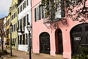 A colorful pastel building facades on Rainbow Row along East Bay Street in historic Charleston, SC.