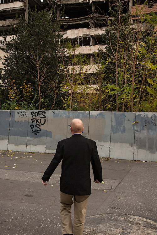Norwegian writer Kristian Kahrs in Belgrade in front of the ruins of the Department of Defense which was bombed during the NATO War of 1999-2000...Photographed for Plot Magazine.