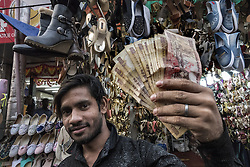 KOLKATA, Nov. 9, 2016 (Xinhua) -- An Indian shop owner shows banned currency notes of 500 and 1,000 in Kolkata, capital of eastern Indian state West Bengal, Nov. 9, 2016. India Tuesday night abolished currency notes of 500 and 1,000 denomination in one of the biggest revolutionary monetary reforms since independence, aimed at curbing the menace of black money. All ATMs and banks remain shut on Wednesday and Thursday. (Xinhua/Tumpa Mondal).****Authorized by ytfs* (Credit Image: © Tumpa Mondal/Xinhua via ZUMA Wire)