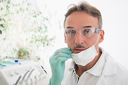 Portrait of dentist with protective mask and safety glasses, Munich, Bavaria, Germany
