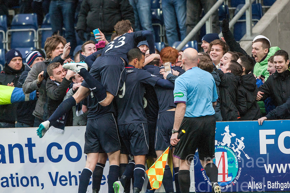 Falkirk's Mark Millar celebrates with team mates and fans after scoring their goal<br /> Falkirk 1 v 0 Queen of the South, Scottish Championship game today at the Falkirk Stadium.<br /> © Michael Schofield.
