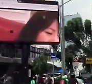 """Somebody put Japanese porn up on a huge Videotron billboard at a major Jakarta intersection<br /> <br /> The large LED video screen billboard (often referred to as a Videotron) at a major intersection in Kebayoran Baru, South Jakarta (along the Antasari flyover and right in front of the South Jakarta Mayor's office!) briefly showed a very explicit pornographic film (believed to be Japanese from the title still visible in the browser tab at the top of the screen) for some time this afternoon.<br /> The head of public relations for South Jakarta, Ady Wiryono Lestari, said electricity was cut from the billboard at 2:45 pm in order to prevent any more innocent eyes from seeing the blue film. <br /> """"We received the report and we immediately severed the electricity to there,"""" Lestari told Kompas.<br /> However, Lestari said he did not know who might have been responsible for airing the pornographic content. <br /> <br /> """"[Videotrons of that size] are overseen by the Jakarta Tax Department, not the city. Third party content providers manage content as licensed by the tax authorities,"""" he said.<br /> Police said they are also investigating the possibility that the billboard was somehow hacked.<br /> ©Exclusivepix Media"""