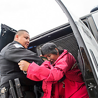 052214       Cable Hoover<br /> <br /> Community Service Aide K. Francisco loads Rose Cadman into the CSA van Thursday near west Highway 66 in Gallup for transport to the detox center.