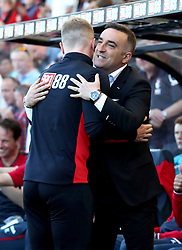 Swansea City manager Carlos Carvalhal (right) and AFC Bournemouth manager Eddie Howe hug before the Premier League match at the Vitality Stadium, Bournemouth.