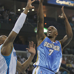 25 March 2009: Denver Nuggets guard Chauncey Billups (7) shoots over New Orleans Hornets forward David West (30) during a NBA game between the New Orleans Hornets and the Denver Nuggets at the New Orleans Arena in New Orleans, Louisiana.