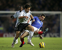 Photo: Lee Earle.<br /> Portsmouth v Chelsea. The Barclays Premiership.<br /> 26/11/2005. Chelsea's Jole Cole (L) skips past the challenge of Andy Griffin.