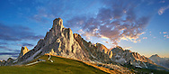 Nuvolau mountain at sunset above the Giau Pass (Passo di Giau), Colle Santa Lucia, Dolomites, Belluno, Italy .<br /> <br /> Visit our ITALY HISTORIC PLACES PHOTO COLLECTION for more   photos of Italy to download or buy as prints https://funkystock.photoshelter.com/gallery-collection/2b-Pictures-Images-of-Italy-Photos-of-Italian-Historic-Landmark-Sites/C0000qxA2zGFjd_k